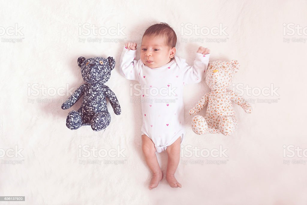 Newborn  go to bed with teddy bear stock photo