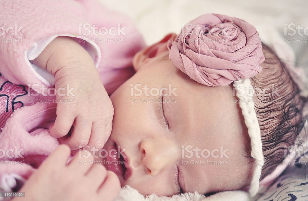 Newborn Little Baby Girl Sleeping On a Bed And Smiling royalty-free stock photo