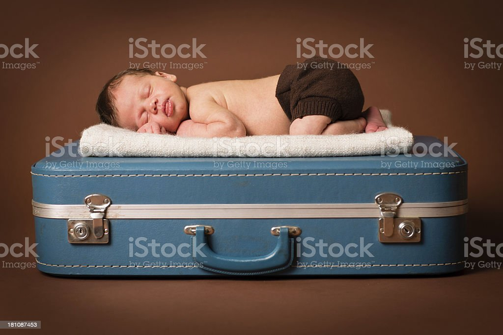 Newborn Lying on Blue Vintage Suitcase royalty-free stock photo