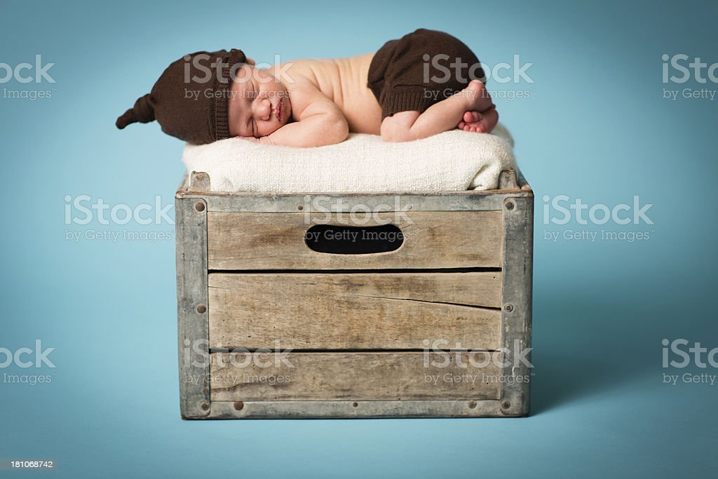 Newborn Lying on Old Wood Crate royalty-free stock photo