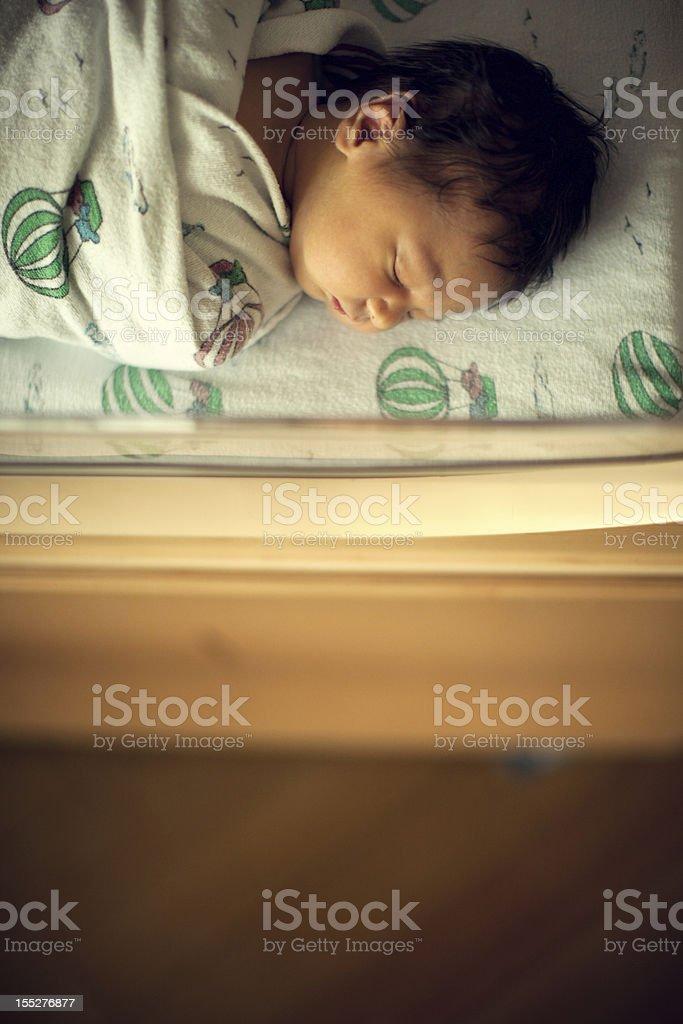 Newborn Sleeping Baby Boy in Hospital Bassinet stock photo