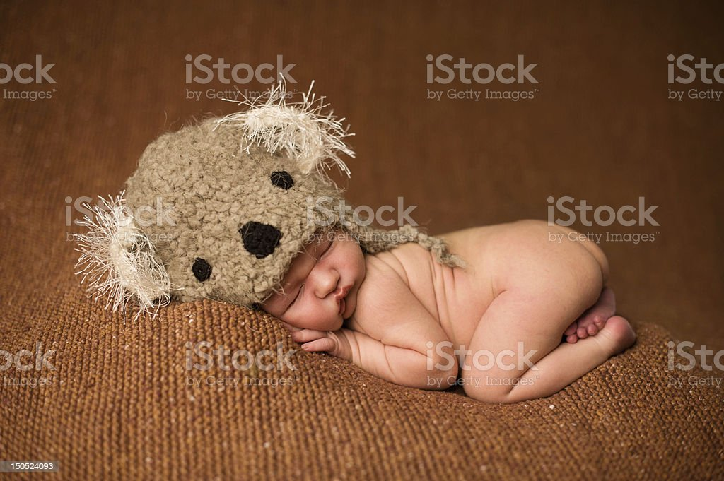 Newborn Sleeping in a Knit Hat stock photo