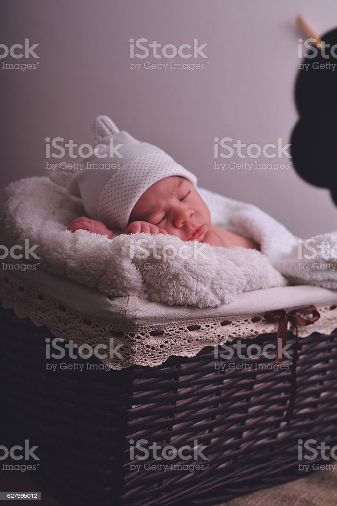 Newborn sleeping in blanket and sing Hello stock photo