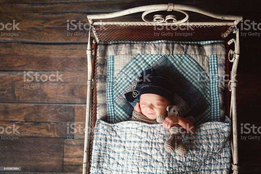 Newborn Sleeping in Little Bed stock photo