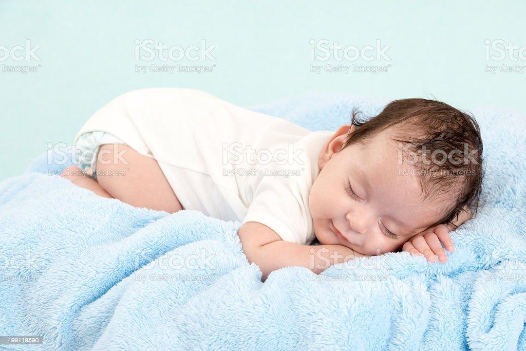 Newborn sleeping peacefully. stock photo
