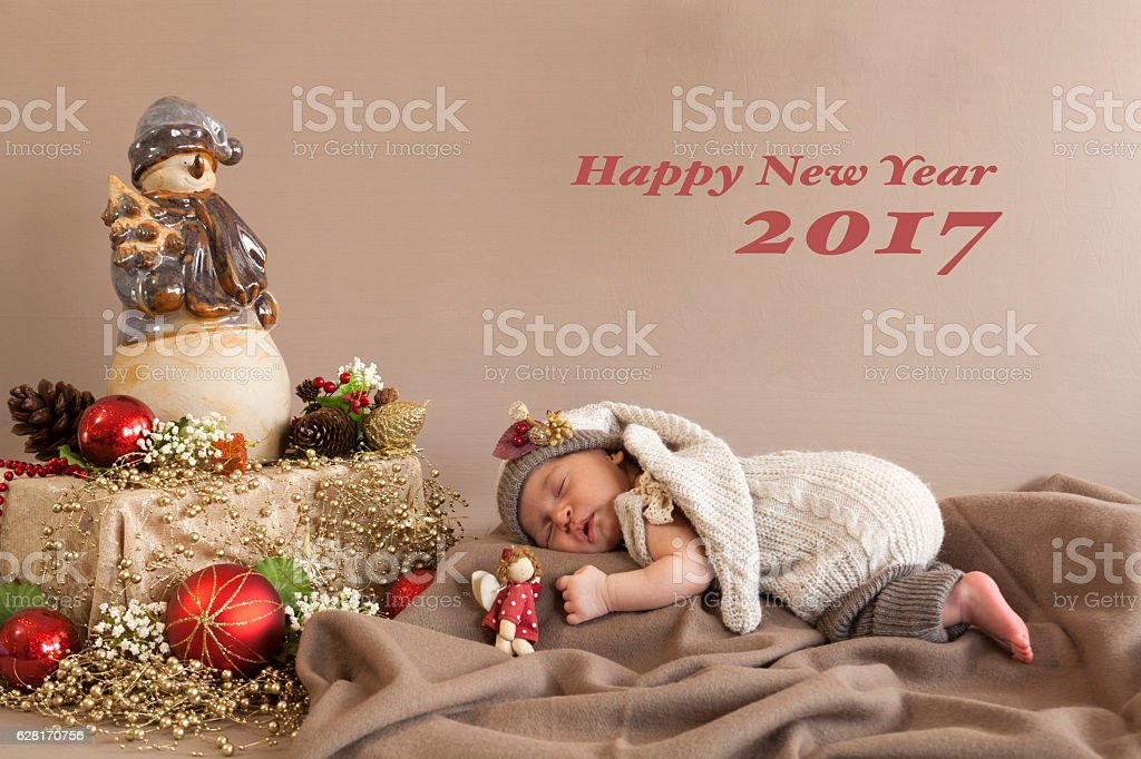 Newborn Sleeping with New Year Concept stock photo