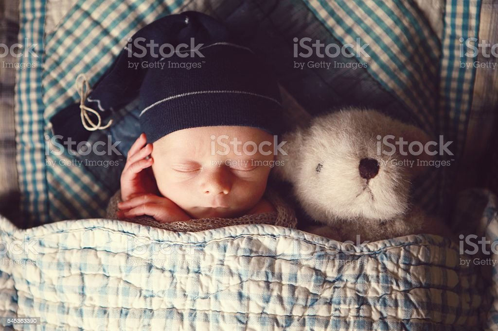 Newborn Sleeping With Teddy Bear stock photo