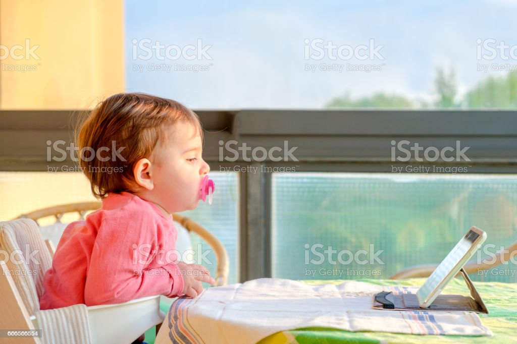 newborn tablet tv digital native stock photo