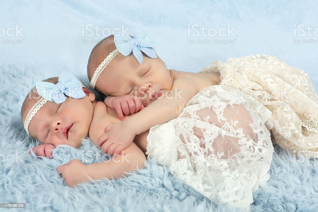 Newborn twin girls stock photo