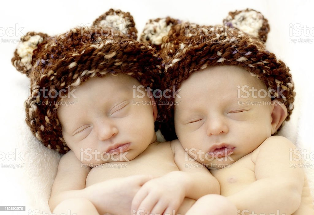 Newborn twins in knit hats royalty-free stock photo