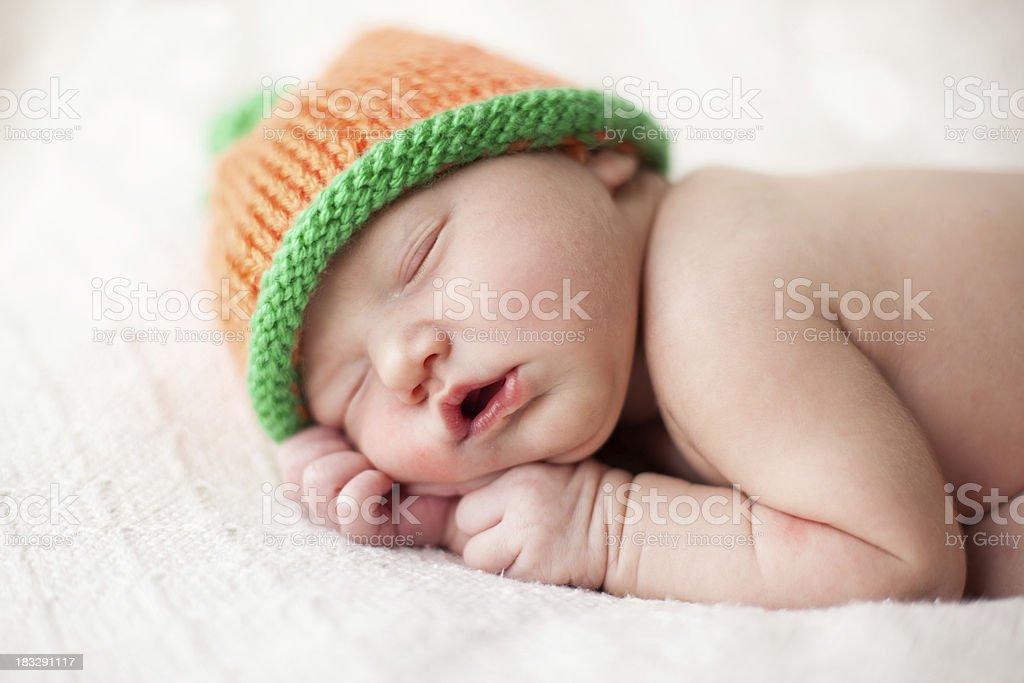 Newborn with Pumpkin hat stock photo
