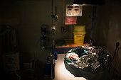 Newborn wrapped in aluminum foil in hospital