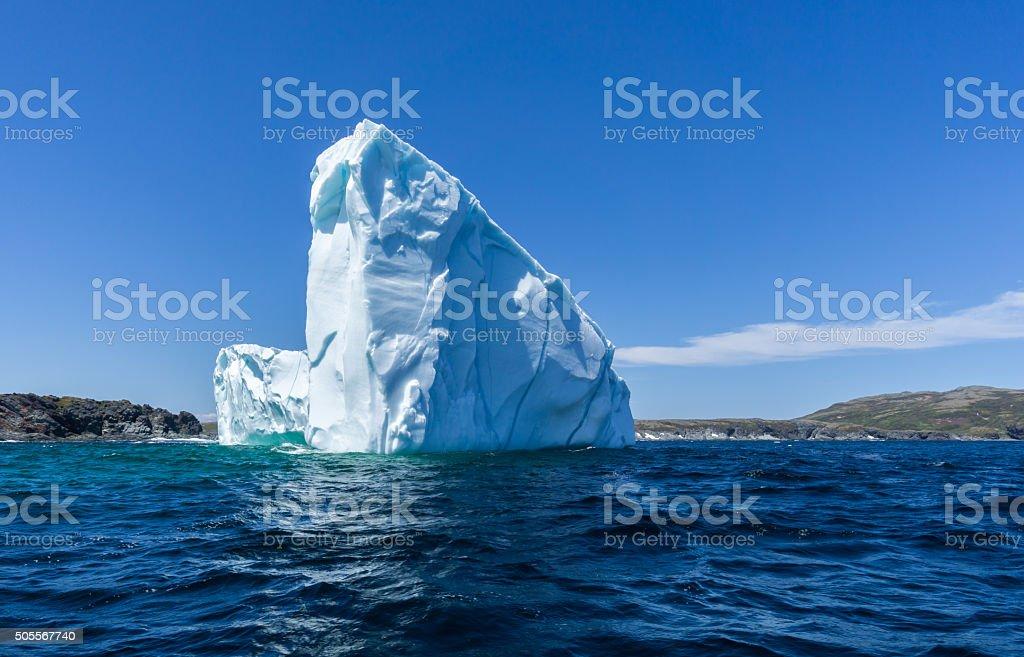 Newfoundland Iceberg and Rugged Shoreline stock photo