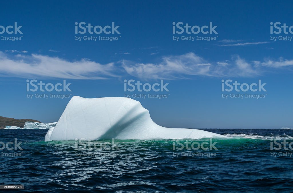 Newfoundland Iceberg and Wispy Cloudscape stock photo