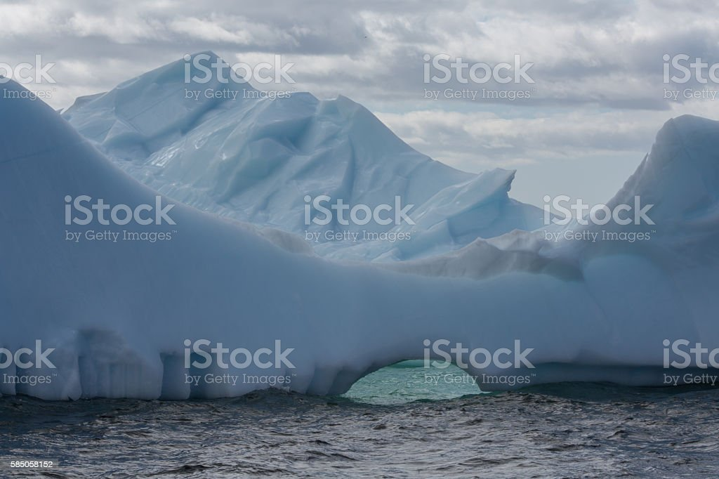 Newfoundland iceberg with clouds behind stock photo