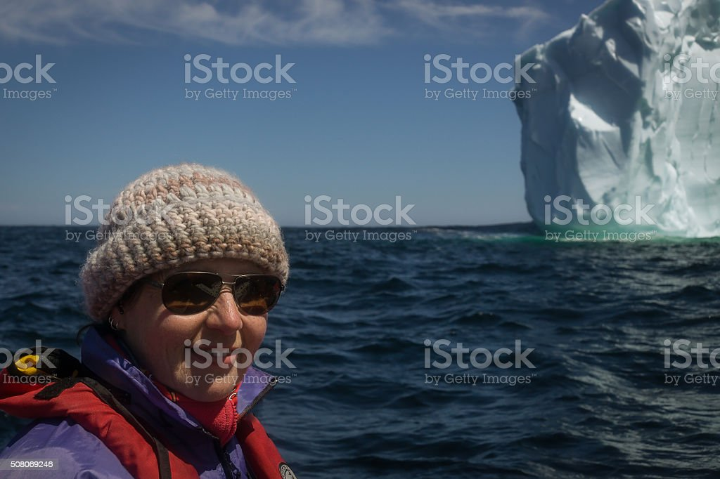 Newfoundland Tourist and Iceberg stock photo