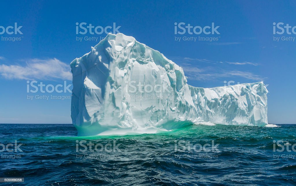 Newfoundland Turquoise Iceberg on a Clear Sunny Day stock photo