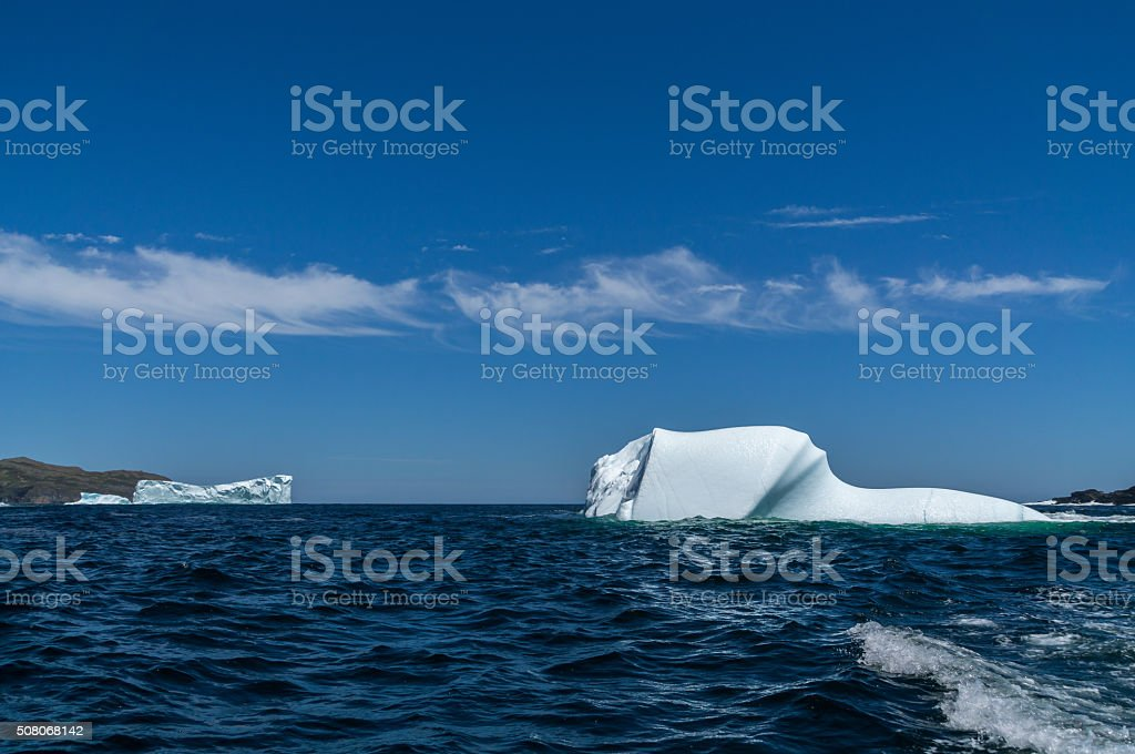 Newfoundland Two Different Shaped Icebergs stock photo