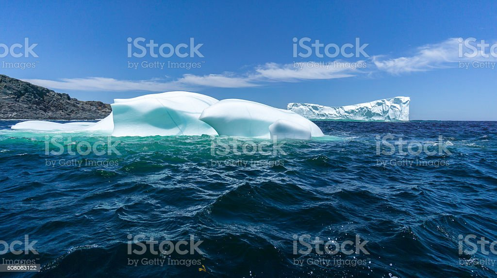 Newfoundland Two Icebergs Compete for Attention stock photo