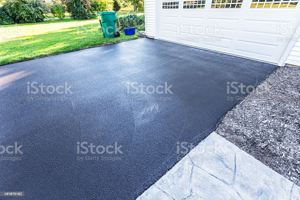Newly Blacktop Sealed Asphalt Driveway stock photo