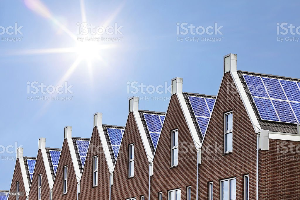 Newly build houses with solar panels attached on the roof stock photo