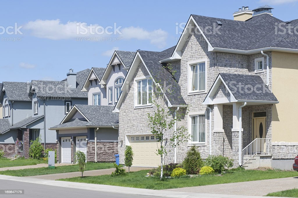 Newly built homes with attached garages and driveways stock photo