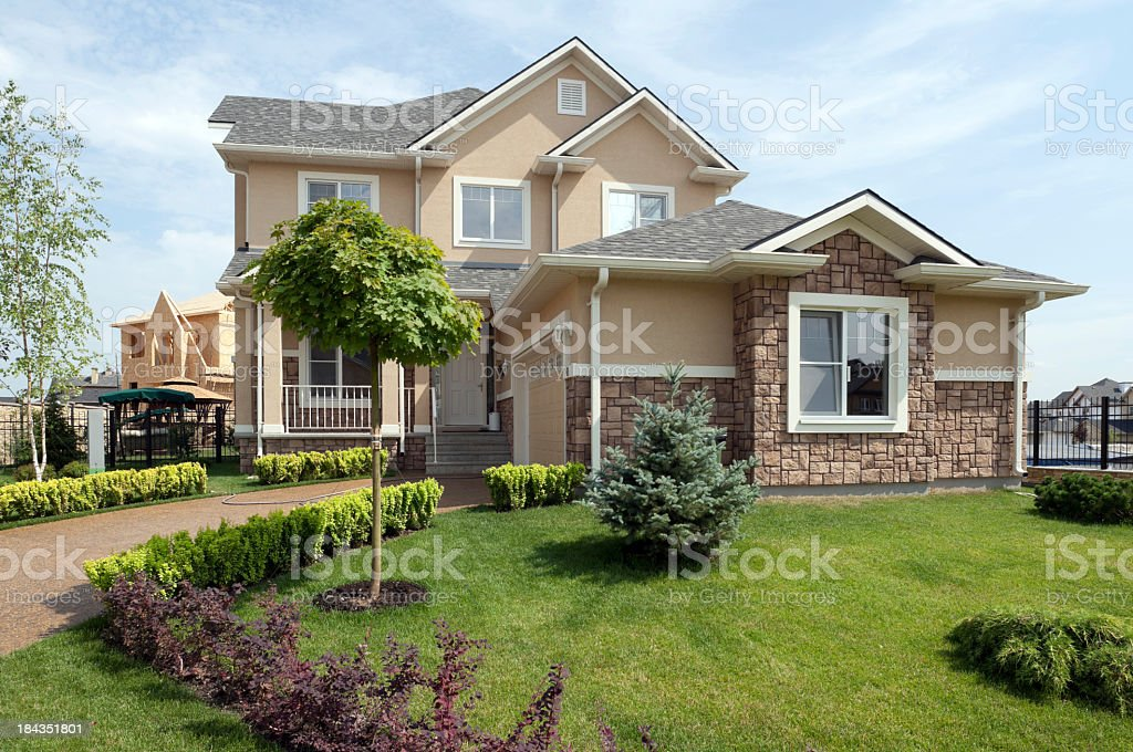Newly constructed home in the suburbs with nice yard  stock photo