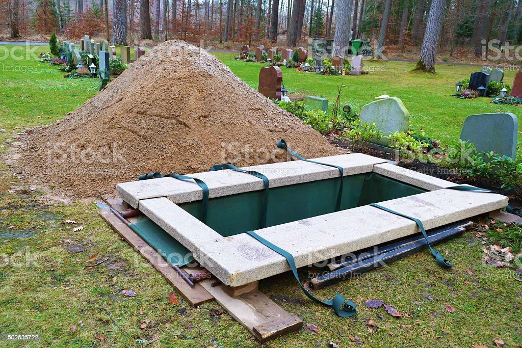 Newly dug grave stock photo