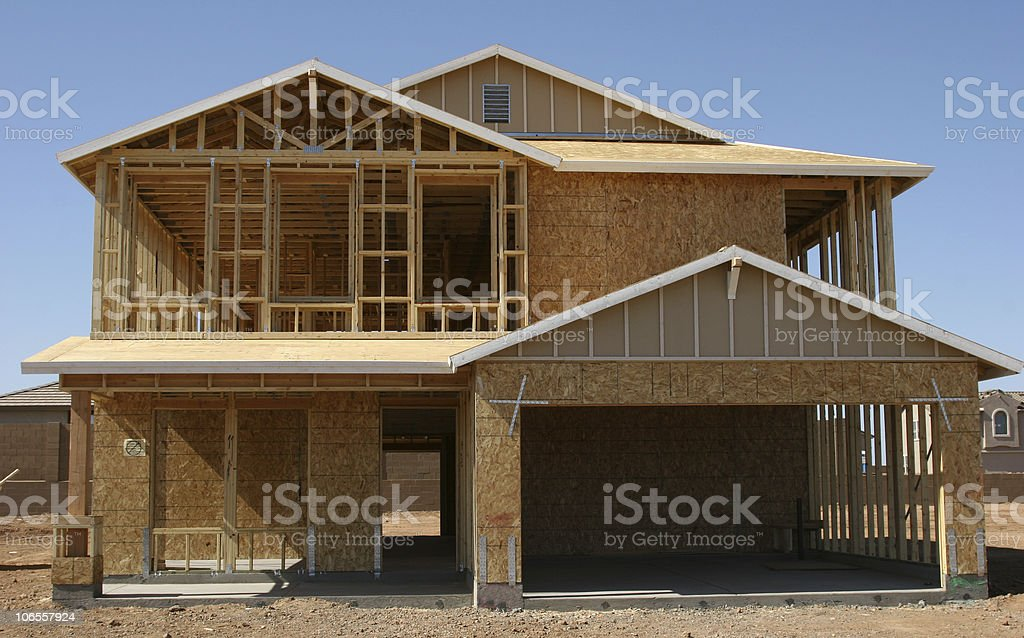 Newly framed home on construction site stock photo