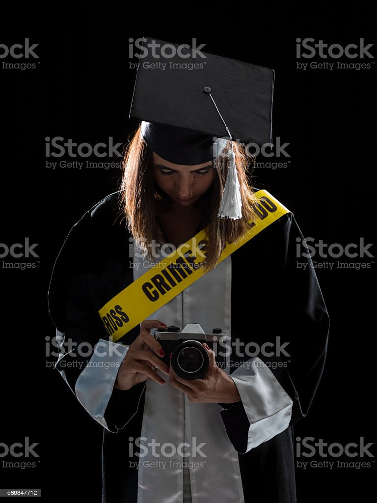 Newly Graduate Female Journalist With Crime Scene Tape Holding Camera stock photo