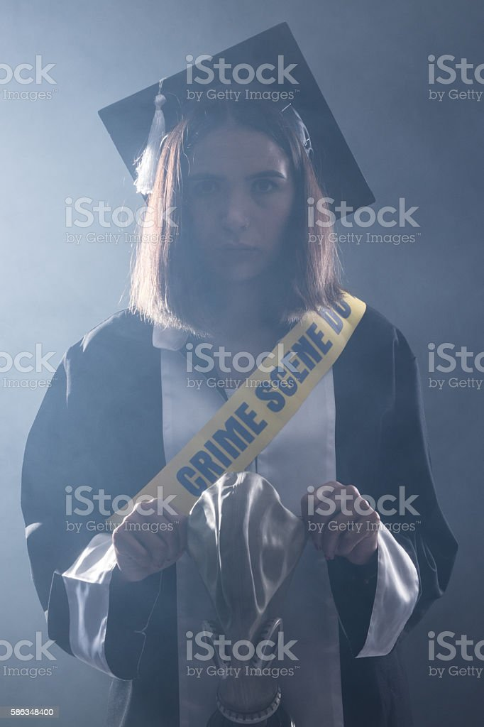 Newly Graduate Journalist With Crime Scene Tape Holding Gas Mask stock photo