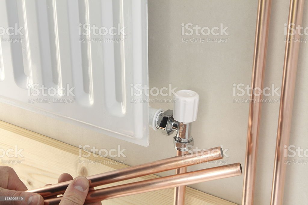 Newly installed central heating radiator. royalty-free stock photo