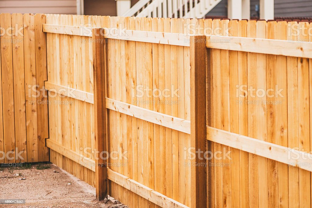 Newly installed fencing in back yard stock photo