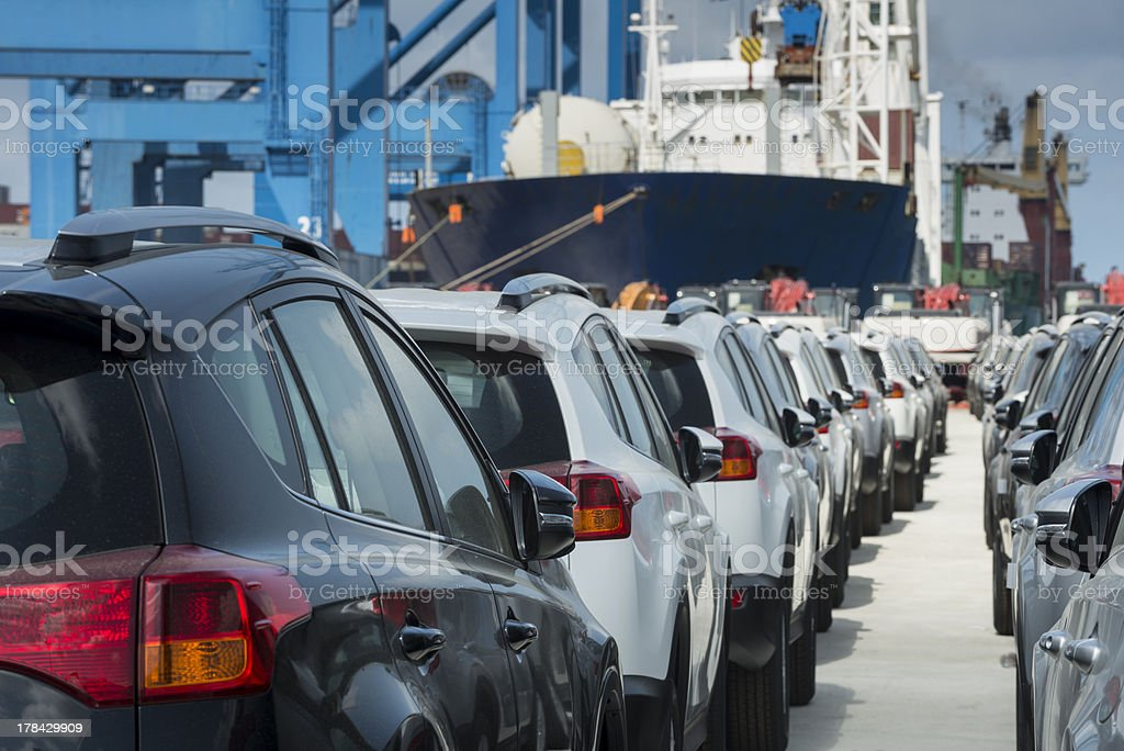 Newly manufactured cars lined up and ready to be exported  royalty-free stock photo