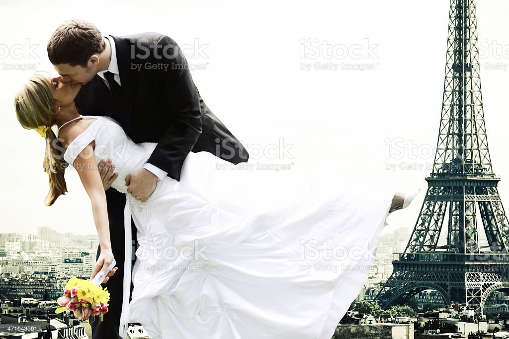 Newly married couple outside the Eiffel Tower stock photo