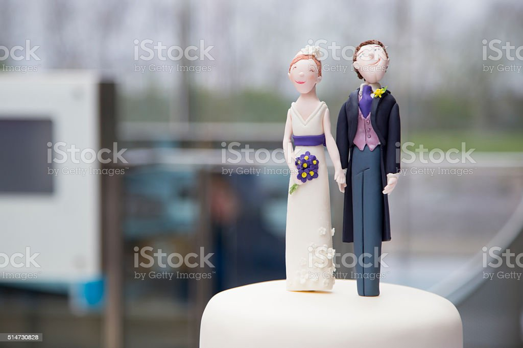 Newly married couple wedding fugurine stock photo