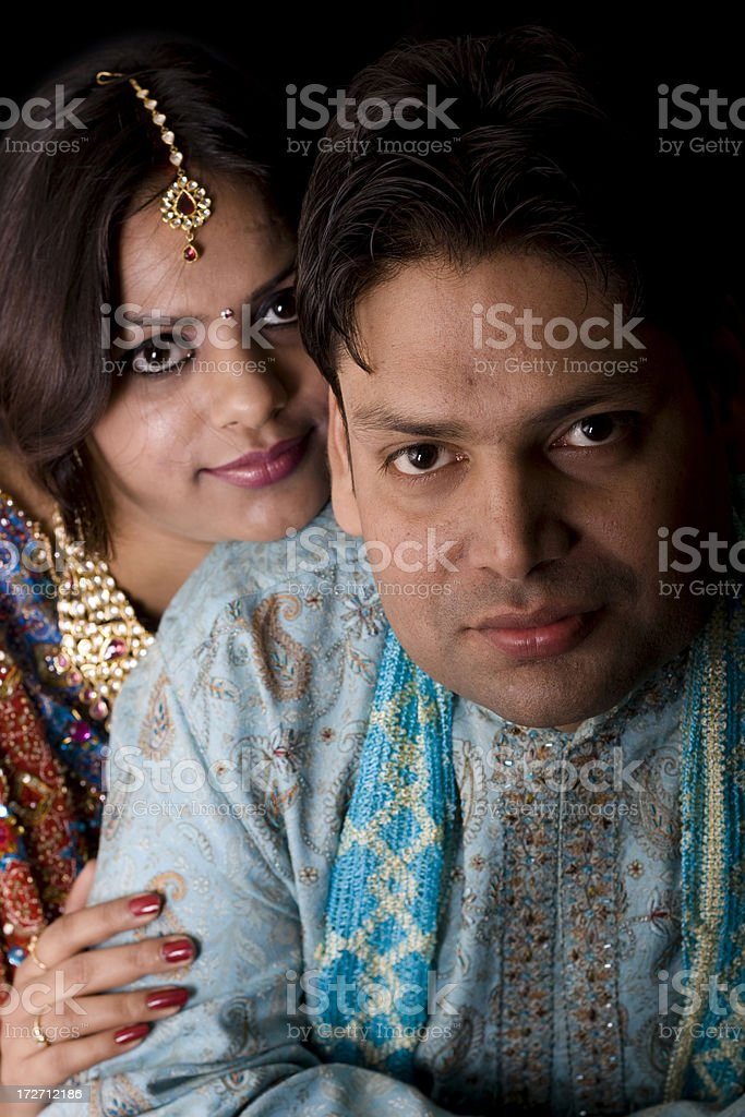 Newly Wed Indian Asian Couple vertical dark portrait royalty-free stock photo