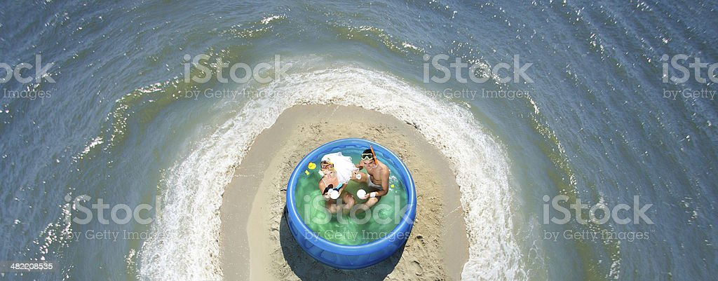 Newly-married couple enjoying on the beach royalty-free stock photo