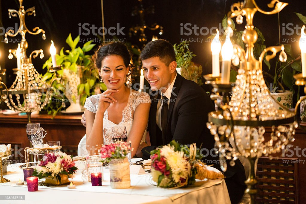 Newlywed couple having a dinner stock photo