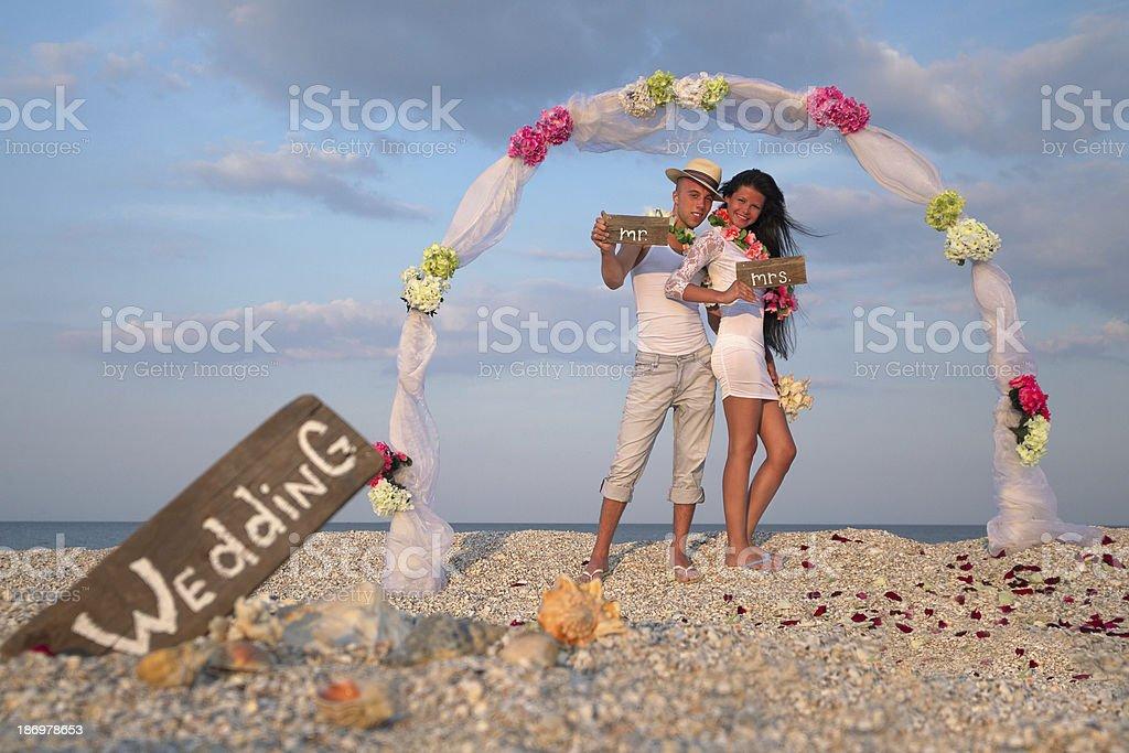 Newlywed couple in Hawaiian Hula royalty-free stock photo