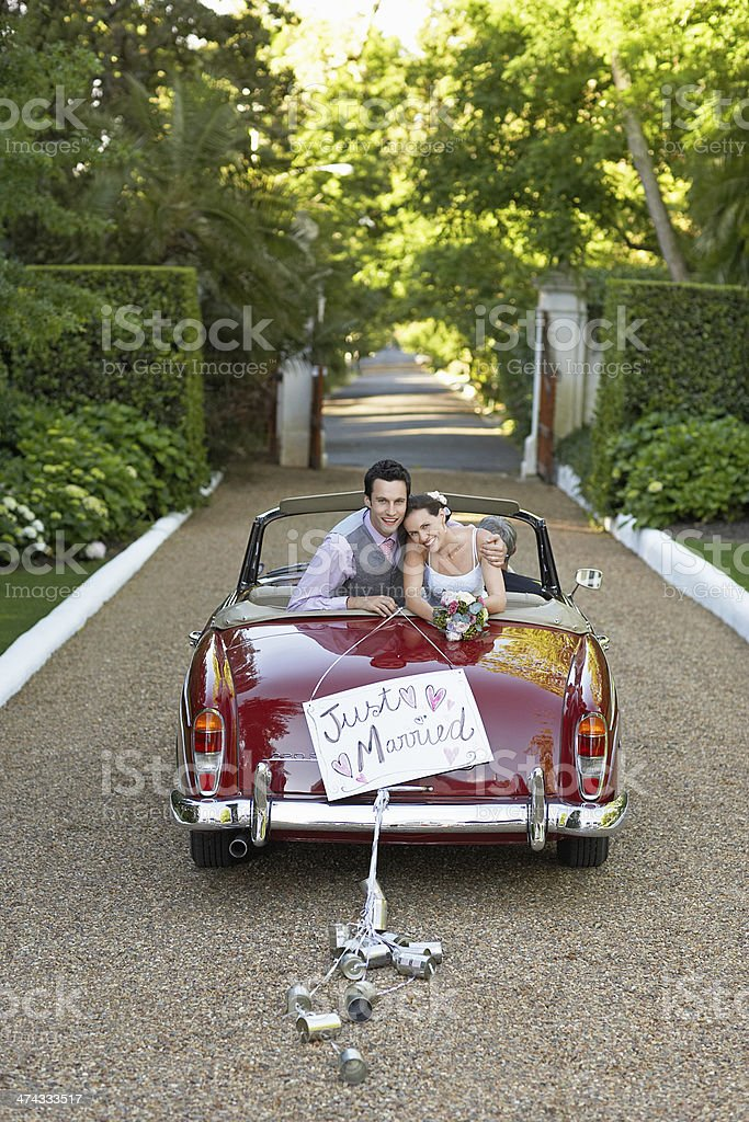 Newlywed Couple In Retro Wedding Car stock photo