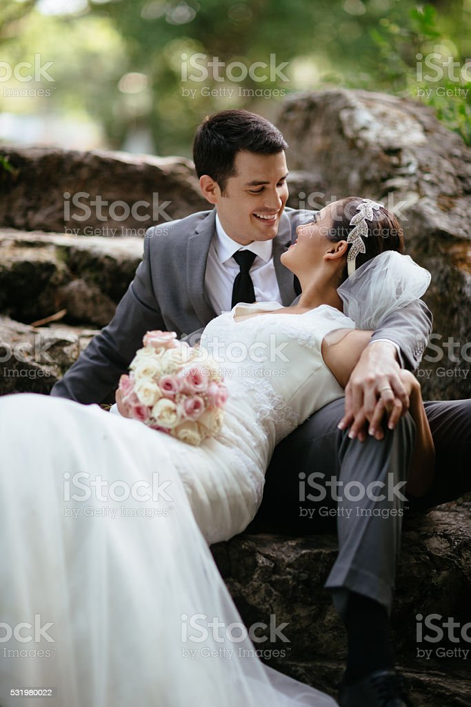 Newlywed couple looking at each other stock photo