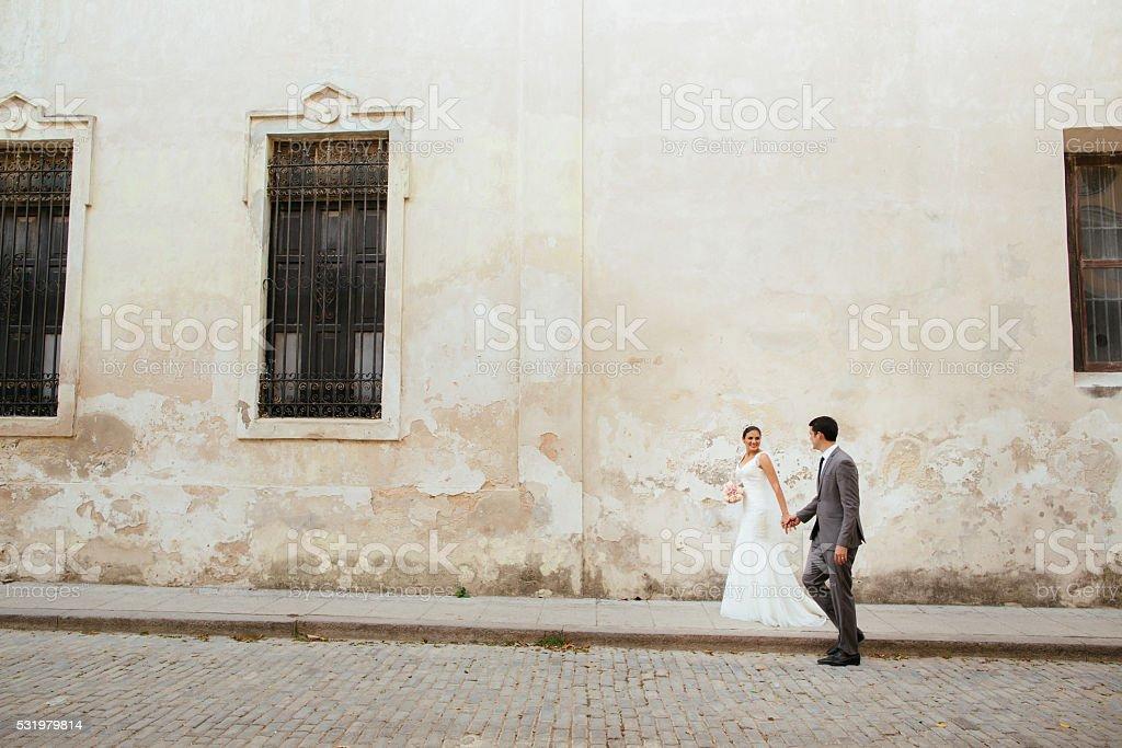 Newlywed couple walking the streets of Havana Cuba stock photo