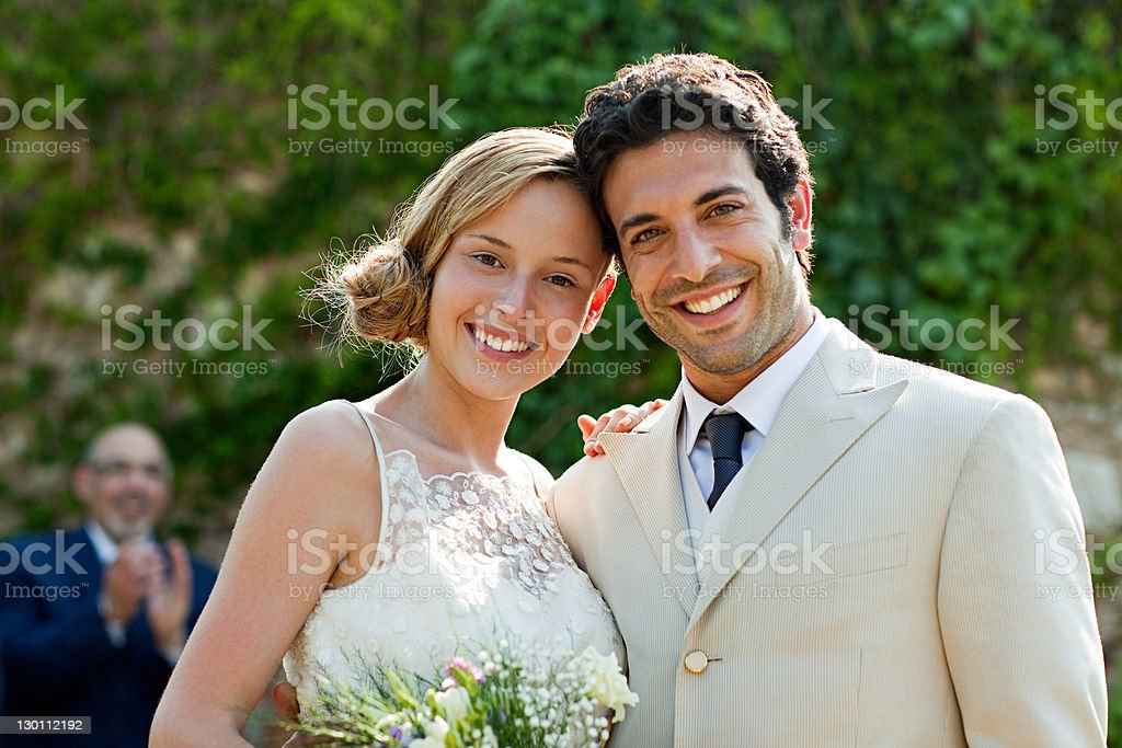 Newlyweds at marriage ceremony, looking at camera stock photo