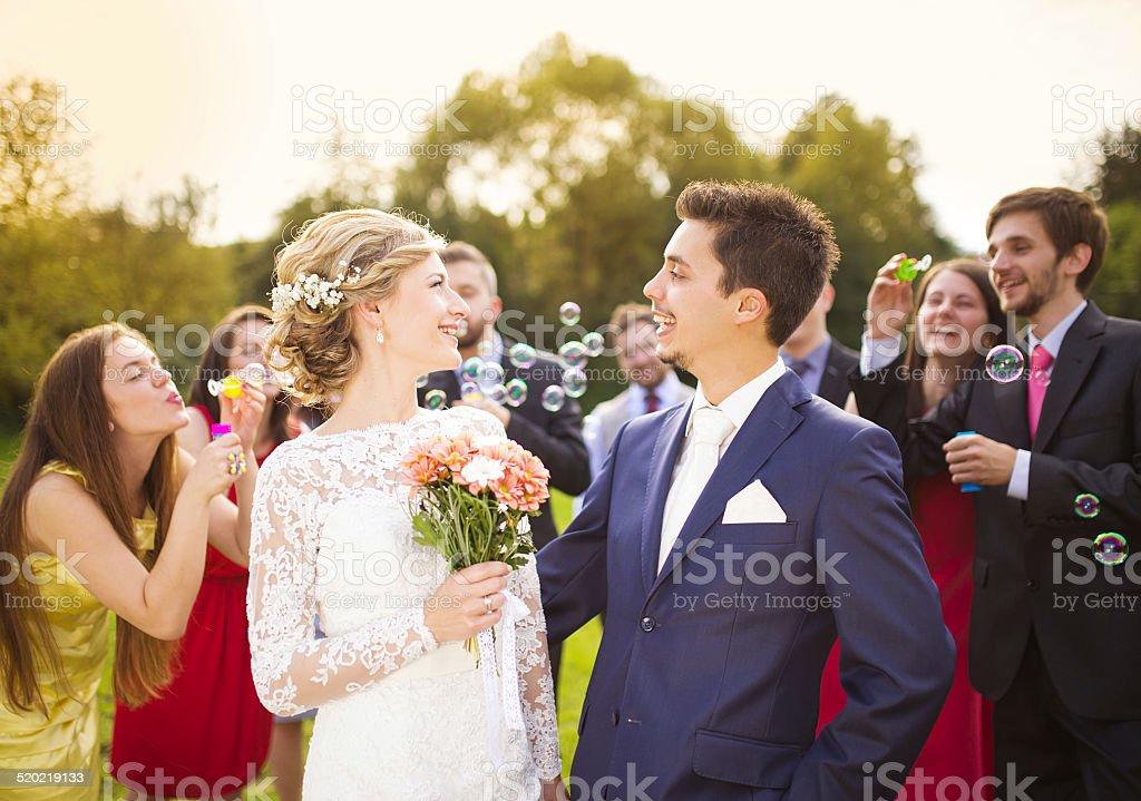 Newlyweds at wedding reception stock photo