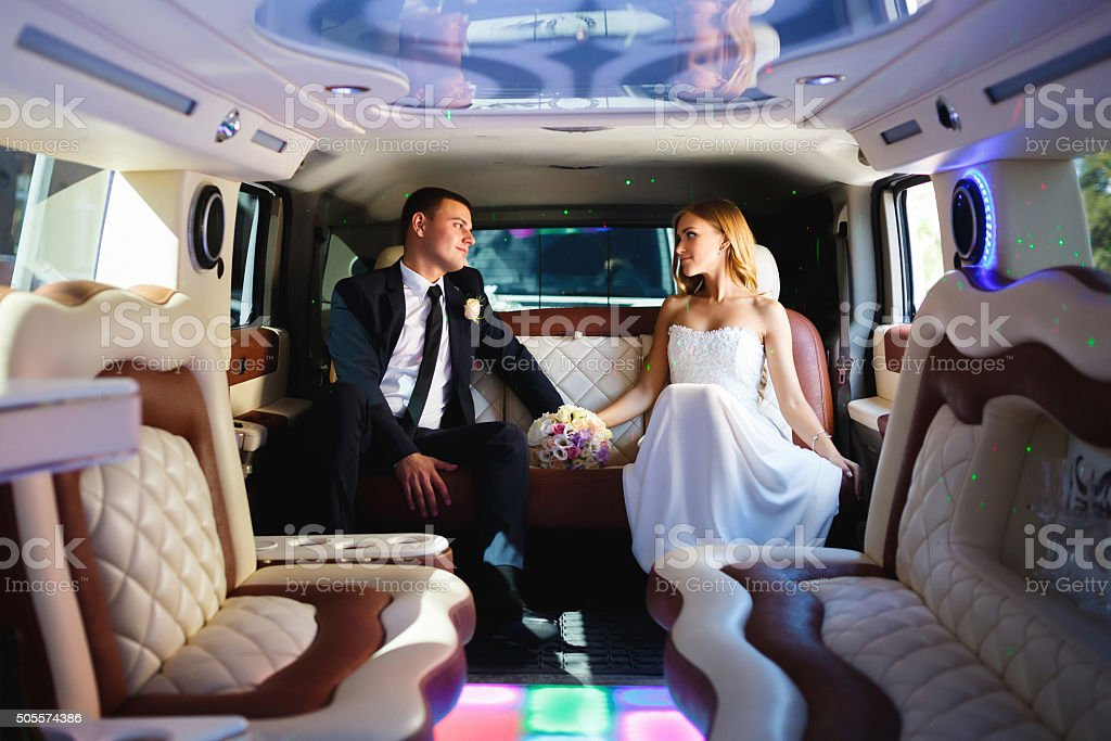 Newlyweds in a car stock photo
