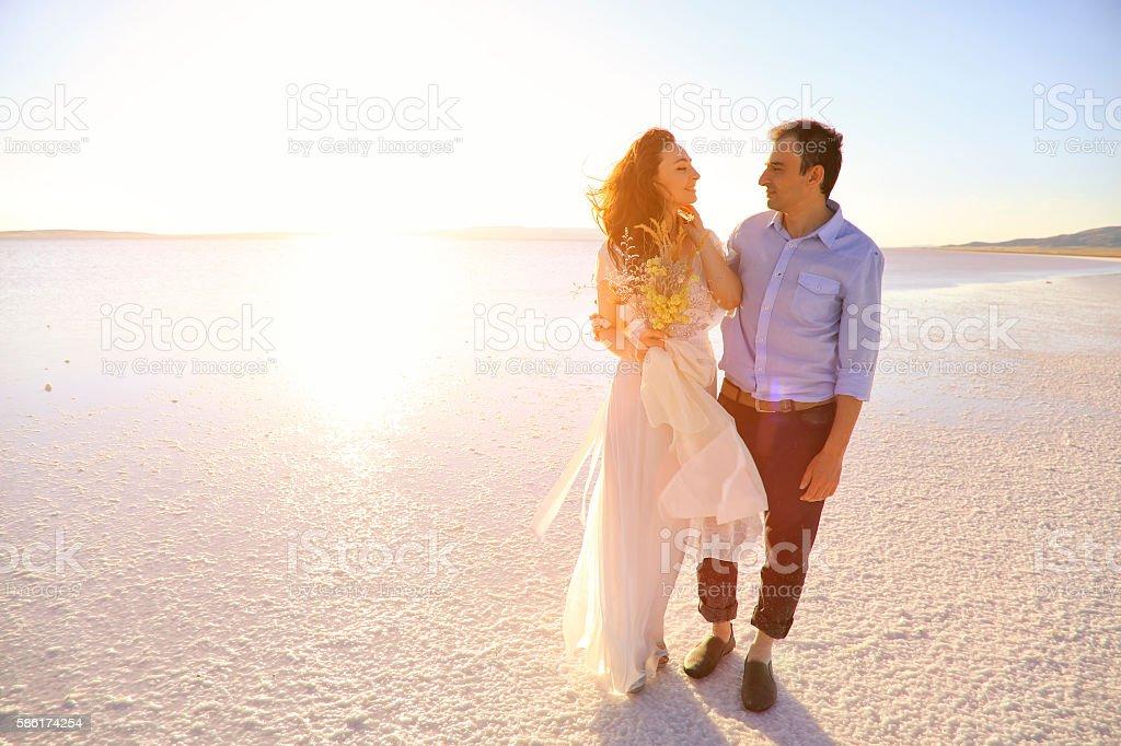 Newlyweds in Salt lake, Turkey stock photo