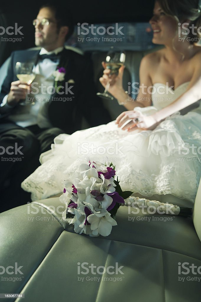 Newlyweds in the limousine stock photo