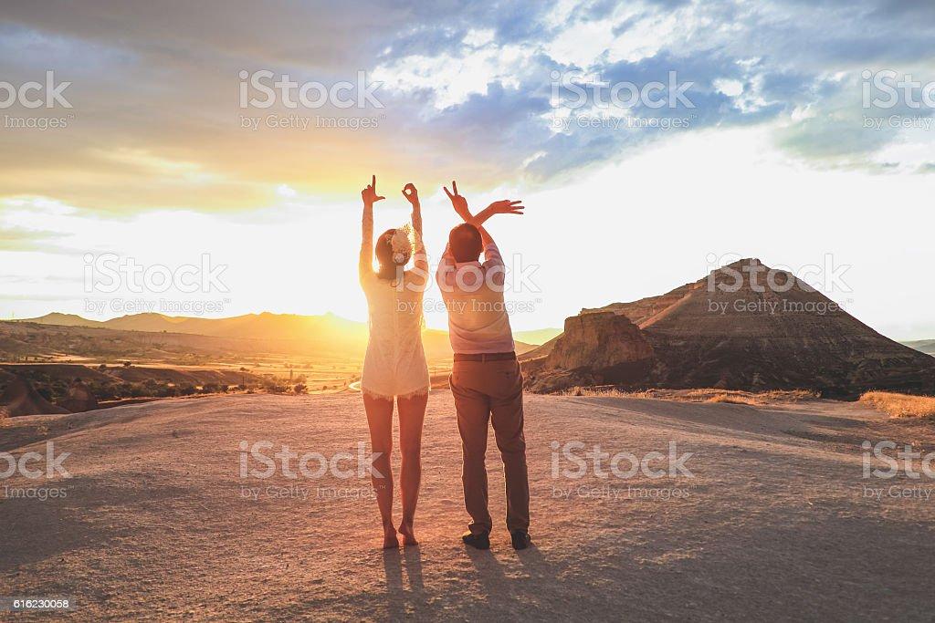 Newlyweds making heart sign stock photo