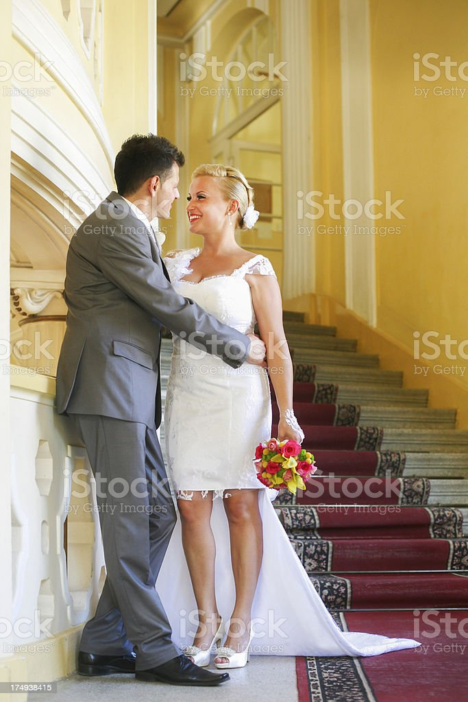 Newlyweds on staircase royalty-free stock photo